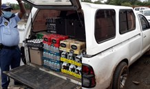 Two suspects arrested for transporting liquor