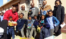 Departmental Officials Donate Winter School Uniform to underprivileged children at Ted Caster Intermediate School.
