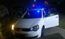Three suspects nabbed with a hijacked vehicle following a shootout with police.