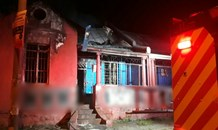 Krugersdorp: angry locals allegedly set fire to two houses used for criminal activity.