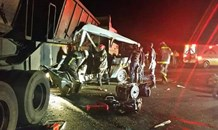 Two dead, at least 11 injured in truck and taxi collision