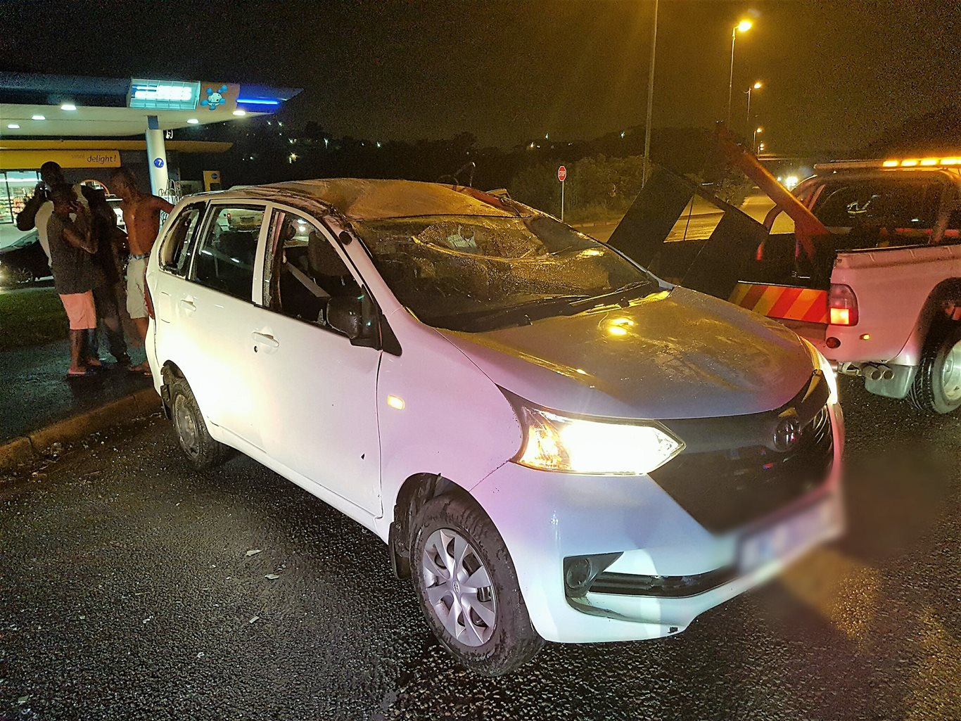 Two People Injured After A Vehicle Overturned On Booth Road Near The