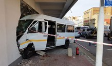 Taxi crashes into business