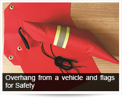 Overhang from a vehicle and flags for Safety
