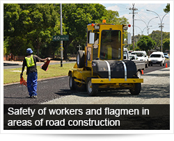 Safety of workers and flagmen in areas of road construction