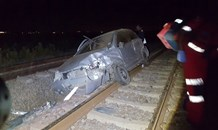 Man seriously injured after being ejected from vehicle that landed on train track