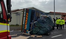 Two injured after truck carrying load overturns