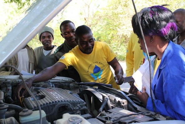 people inspecting a vehicle for road safety readiness
