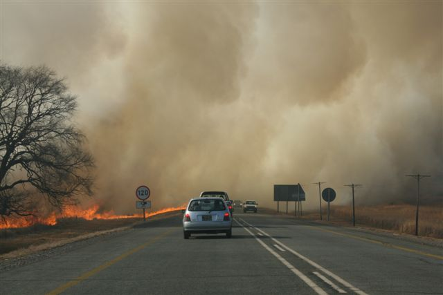 car driving through a veld fire at Schoemanskloof